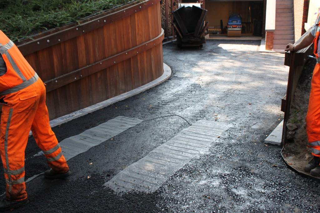opritverwarming in asfalt